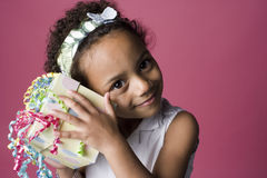 Portrait of a young Black girl with a present Stock Image