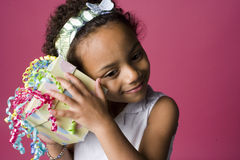 Portrait of a young Black girl with a present Stock Photo