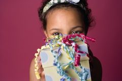 Portrait of a young Black girl with a present Royalty Free Stock Photography