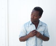 Portrait of a young black man adjusting shirt button outdoors Stock Photography