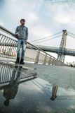 A portrait of a young, black man along NYC`s East River Williams Stock Photography