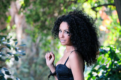 Portrait of a young black woman. In the park Royalty Free Stock Photos