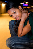 Portrait of young black woman in city at night. Stock Photography