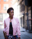 Portrait of young black woman on city street Stock Images