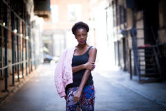 Portrait of young black woman on city street Stock Image