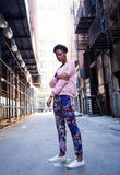Portrait of young black woman in dark city street Royalty Free Stock Images