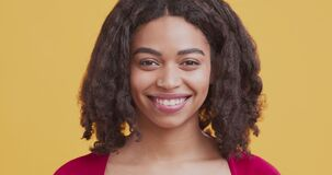 Portrait of young black woman with happy smile on face