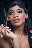Portrait of young black woman, isolated on black royalty free stock photos