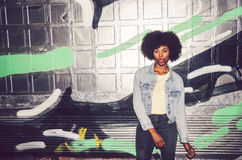 Portrait of a young black woman, model of fashion in urban backg Stock Photo