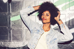 Portrait of a young black woman, model of fashion in urban backg Stock Photography