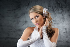 Portrait of a young blond bride in a white dress Stock Image