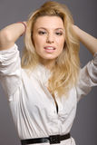 Portrait of young blond fashion model on grey Royalty Free Stock Photos