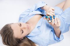 Portrait of Young Blond Female Dealing with Rubik's Cube Royalty Free Stock Images