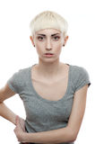 Portrait of young blond girl. In gray t-shirt isolated on white Stock Image