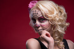 Portrait of young blond girl with Calaveras makeup Stock Photography