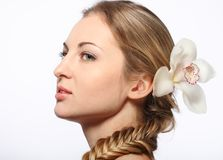 Portrait of the young blond girl with orchid Royalty Free Stock Images