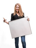 Portrait of a young blond holding empty billboard Stock Images