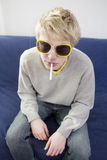 Portrait of young blond man smoking cigarette Royalty Free Stock Photo