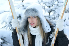 Portrait of a young blond in a winter hat with ski Stock Image