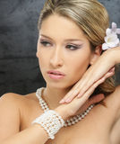 Portrait of a young blond woman in beautiful makeup Stock Photography