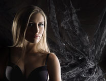 Portrait of a young blond woman in a black bra Royalty Free Stock Image