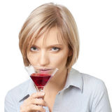 Portrait of young blond woman drinking  a martini. Cocktail, over white background Royalty Free Stock Photos