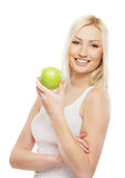 Portrait of a young blond woman holding an apple Royalty Free Stock Photography