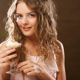 Portrait of young blond woman holding cafe latte cup Royalty Free Stock Photography