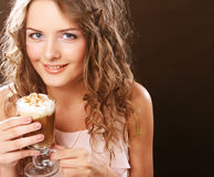 Portrait of young blond woman holding cafe latte cup Royalty Free Stock Photos
