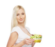 Portrait of a young blond woman holding a salad Royalty Free Stock Image