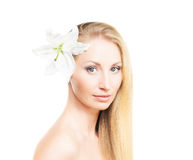 Portrait of a young blond woman with a lily flower Stock Photography