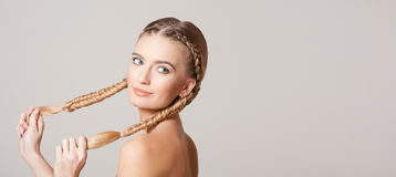 Blond beauty with amazing hair. Portrait of a young blond woman with long healthy hair royalty free stock images