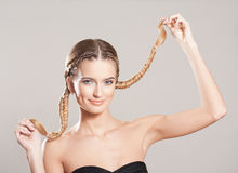 Blond beauty with amazing hair. Portrait of a young blond woman with long healthy hair stock photo