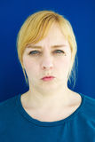 Portrait of young blond woman looking angry Stock Images