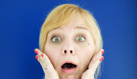 Portrait of young blond woman looking surprised Stock Photography