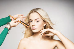 Portrait of a young blond woman in makeup Stock Photography