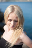 Portrait of young blond woman outdoors Royalty Free Stock Photography