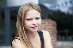 Portrait of young blond woman outside Stock Image