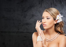Portrait of a young blond woman in pearl jewelry Royalty Free Stock Photos