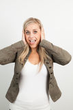 Portrait of a young blond woman smiling and doing a funny face Stock Photography