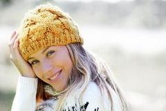 Portrait of young blond woman wearing winter clothes Royalty Free Stock Photos
