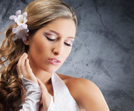 Portrait of a young blond woman in a white dress Royalty Free Stock Images