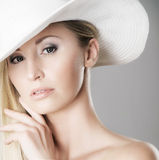 Portrait of a young blond woman in a white hat Royalty Free Stock Photo