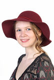 Portrait of young woman in red hat Stock Photo