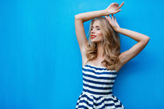 Portrait of young blonde on a blue background Royalty Free Stock Image