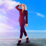 Portrait of young blonde business lady in black suit Royalty Free Stock Photo