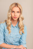 Portrait of a young blonde casual woman Royalty Free Stock Photos