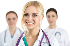 Portrait of young blonde female doctor surrounded by medical tea Royalty Free Stock Image