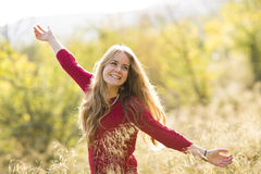Portrait of a young blonde female on field. Beautiful woman. Royalty Free Stock Photography