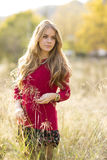 Portrait of a young blonde female on field. Beautiful woman. Royalty Free Stock Photo
